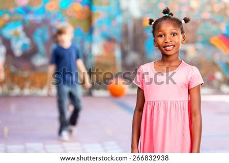 Elementary school children happy playing basketball at school. - stock photo