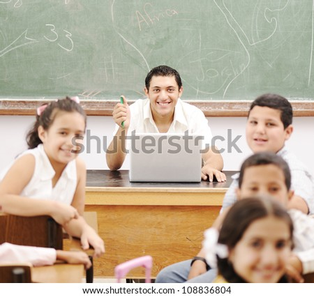 Elementary school kids in classroom - stock photo