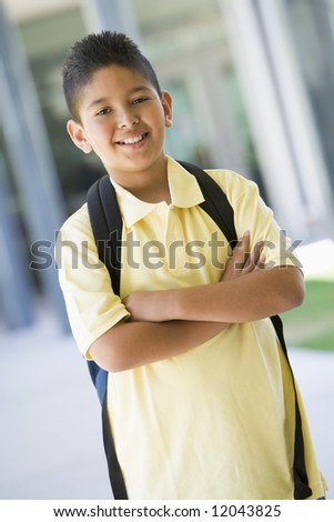 Elementary school pupil outside with backpack