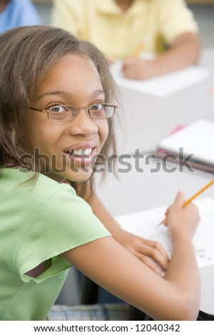 Elementary school pupil working at desk