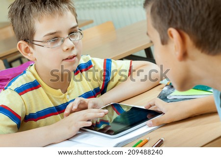 Elementary School Students at Classroom Desks - stock photo