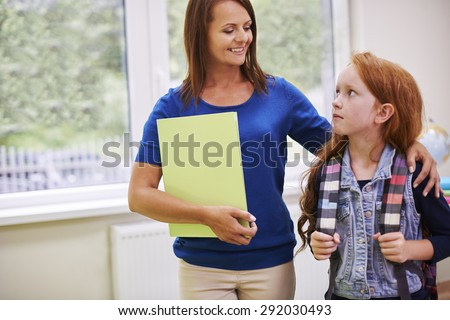 Elementary student talking to her teacher