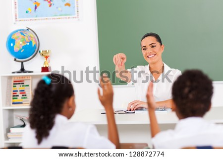 elementary teacher calling students in classroom