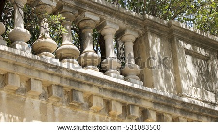 Elements of a classical baluster in a summer park