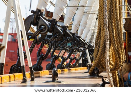 Elements of equipment of a old sailing vessel on the background of clear sky. - stock photo