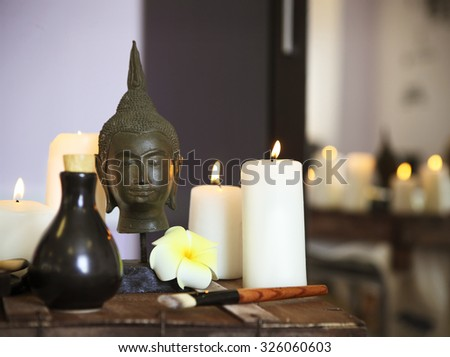 Elements of spa massage with candles in spa salon