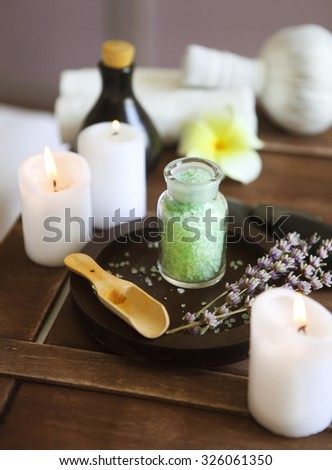 Elements of spa massage with candles in spa salon - stock photo