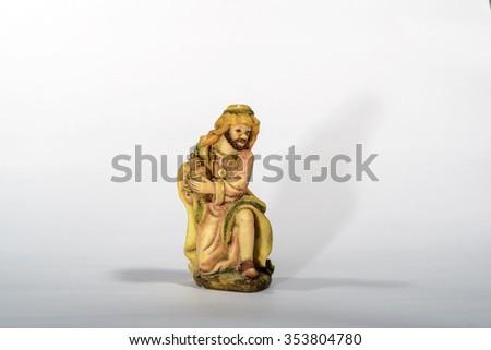 Elements of the Catholic Christian crib onthe white background / The  Wise Man - stock photo