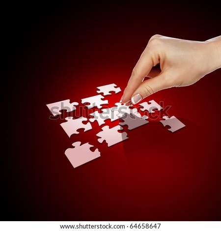 Elements of the puzzle going into a whole. As a symbol of various business solutions.