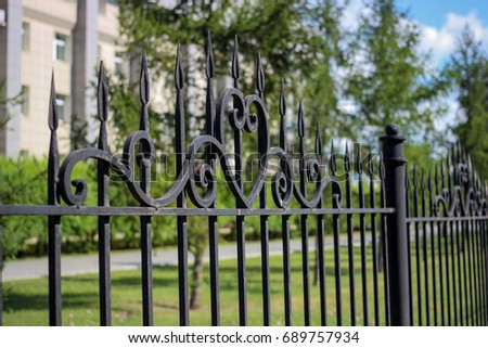 Elements of wrought-iron fences and hedges
