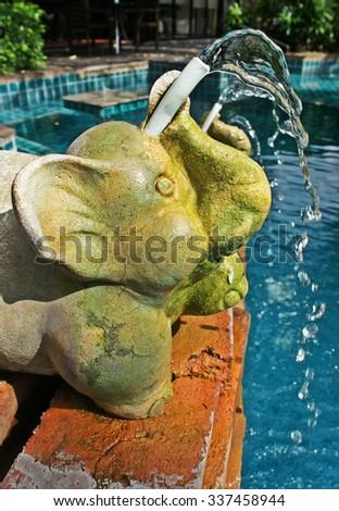 elephant baby statue it looks so cute - stock photo