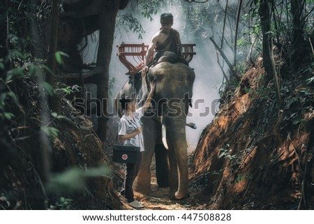 Elephant doctor. A doctor visiting their patients at countryside of Elephant village, Surin Province, Thailand