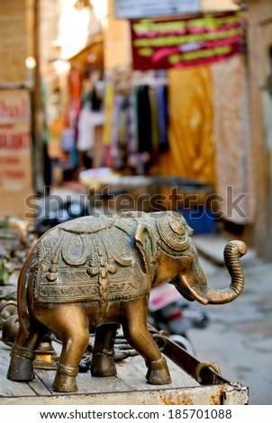 Elephant figure on market stall - stock photo