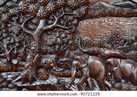 Elephant in the forest thai style art wood carving background texture