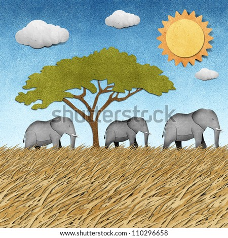 Elephant made from recycled paper background - stock photo