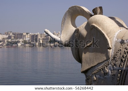 Elephant sculpture on the palace island in Lake Pichola - stock photo