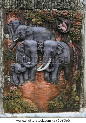 Elephant sculptures. Use to decorate a small waterfall. - stock photo