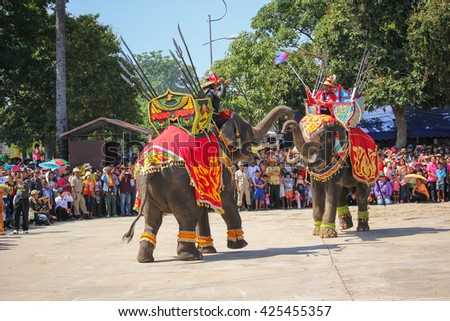Elephant Show war Iuthheete in traditional Thai long boats compete during King Cup Traditional Long Boat Race Championship on NOVEMBER, 2015 in BURIRAM ,Thailand