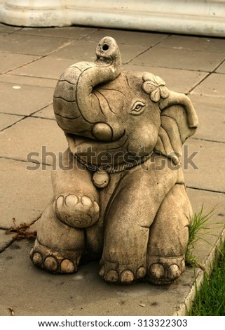 Elephant statue in a sitting position