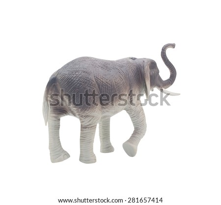 Elephant toy back. Isolated blue and grey elephant toy standing on white background back view.