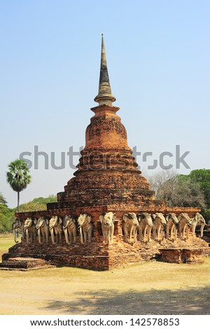 Elephants and brick pagoda in old Sukhothai, Thailand