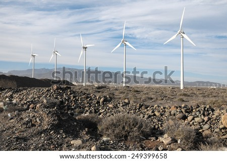 Eletric Power Generator Wind Turbine over a Cloudy Sky - stock photo