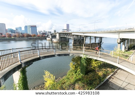 elevated bridge near water with cityscape and skyline of portland - stock photo