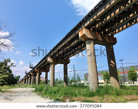 Elevated Chicago CTA subway train tracks outdoors - landscape color photo - stock photo