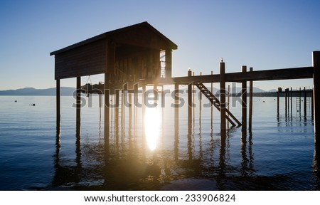 Elevated Pier Walkway to Boathouse Lake Tahoe City Sunrise - stock photo