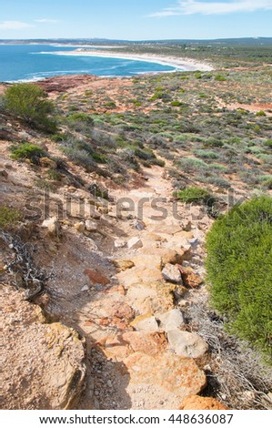 Elevated view from the rugged path to the Red Bluff beach through sandstone and flora in Kalbarri, Western Australia/Path to Red Bluff Beach/Kalbarri, Western Australia