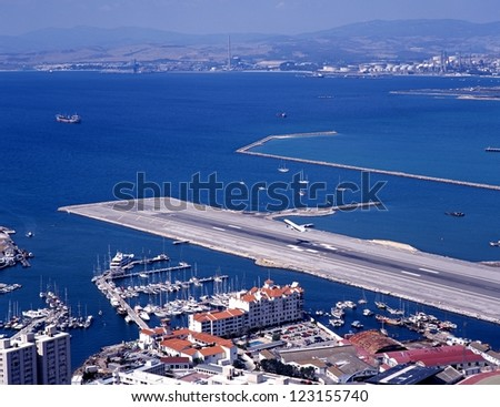 Elevated view of airport runway with the Spanish coastline to the rear, Gibraltar, UK, Western Europe. - stock photo