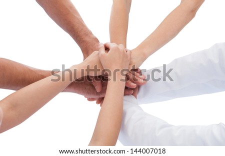 Elevated View Of Doctor Stacking Hands Together Over White Background - stock photo