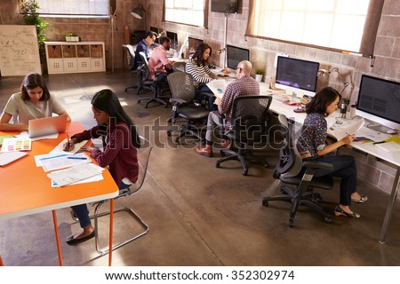 Elevated View Of People Working In Modern Design Office - stock photo