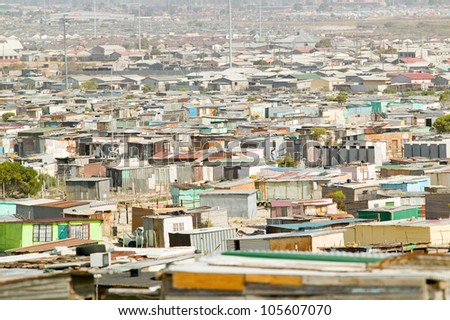Elevated view of shanty towns or Squatter Camps, also known as bidonvilles, in Cape Town, South Africa - stock photo