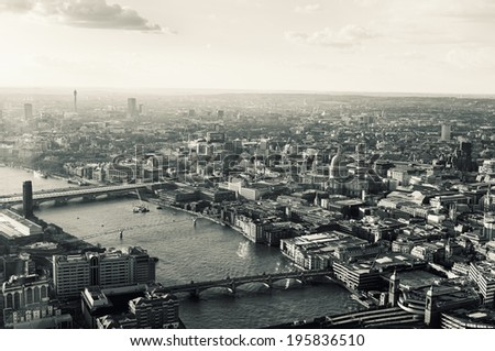 Elevated view of The City of London on a cloudy spring afternoon. Retro toned. - stock photo