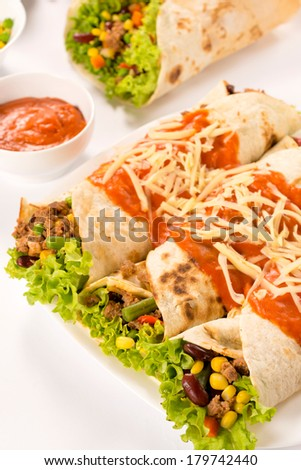 Elevated view of wrap sandwiches on a plate. Selective focus on the front.