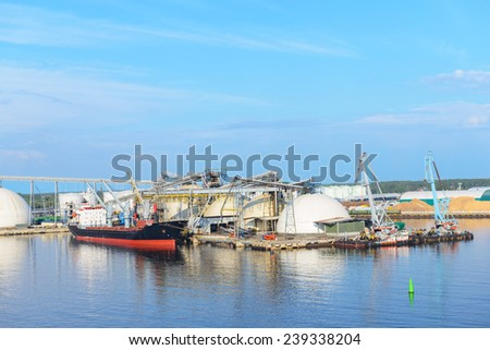 Elevator and cargo vessel - stock photo