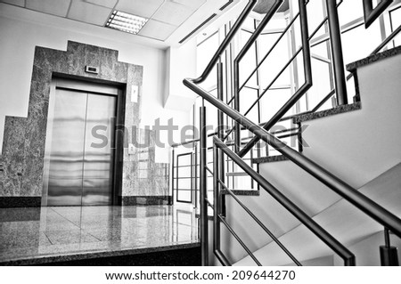 elevator and staircase in office - stock photo