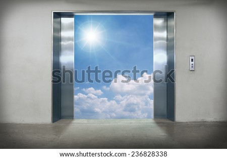 Elevator doors open to the blue sky. - stock photo