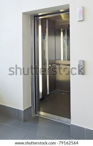 Elevator with open doors - stock photo