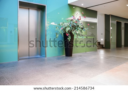 Elevators in entrance hall - stock photo