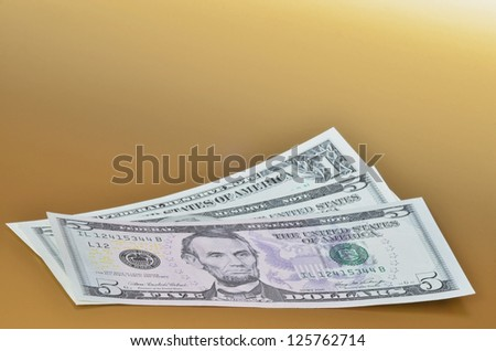 Eleven american dollars on golden background