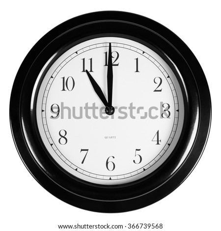 Eleven o'clock on the black wall clock, isolated on white background - stock photo