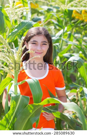 Eleven Year Old Girl in the Cornfield. Summer Rural Concept. - stock photo