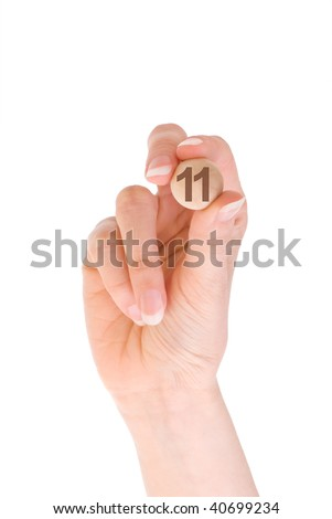 eleventh bingo ball in the hand - stock photo