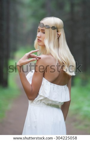 elf.beautiful girl. fantasy young woman in woods - stock photo