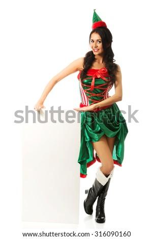 Elf woman holding white empty banner. - stock photo