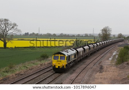 ELFORD, UK - MAY 8: A Freightliner class 66 diesel loco operated coal train heads to a power station situated in the Midlands to drop off its load on May 8, 2015 in Elford