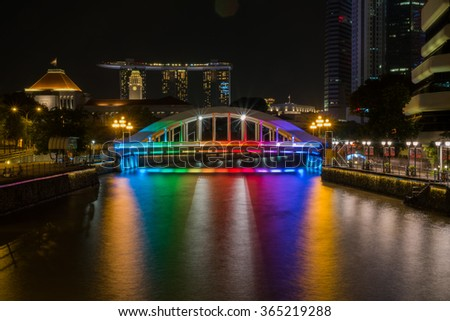 Elgin Bridge at night with lighting by the Singapore River