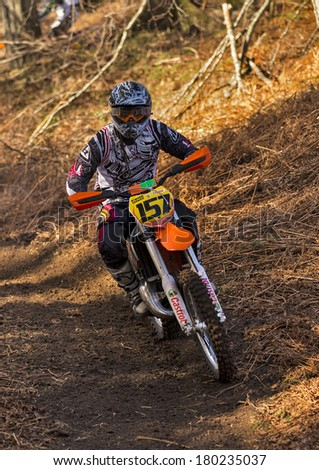 ELGIN, MORAY, SCOTLAND - MARCH 2: An unidentified Motorcyle Enduro Rider  at an open to the public Enduro Track situated within a Forrest at Elgin, Moray, Scotland on 2 March, 2014.